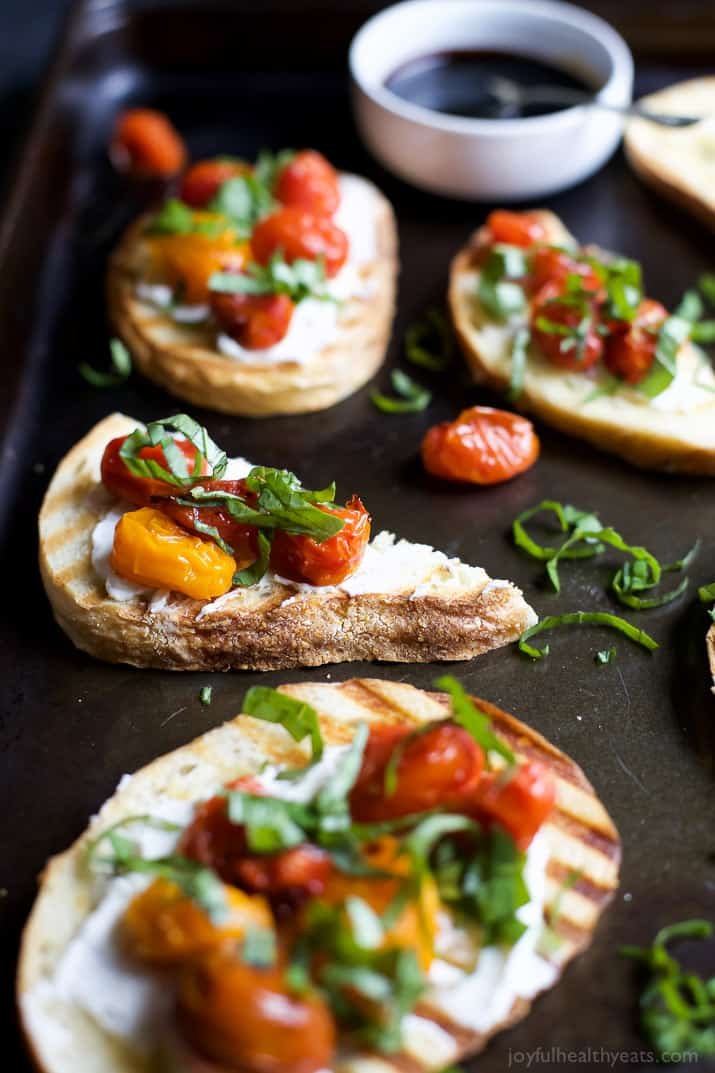 Roasted Tomato Bruschetta with Whipped Goat and a Balsamic Reduction Drizzle - an appetizer that everyone will love and only takes minutes to make!   joyfulhealthyeats.com