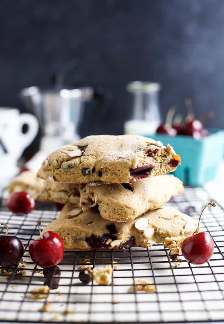 A stack of almond cherry scones on a cooling rack