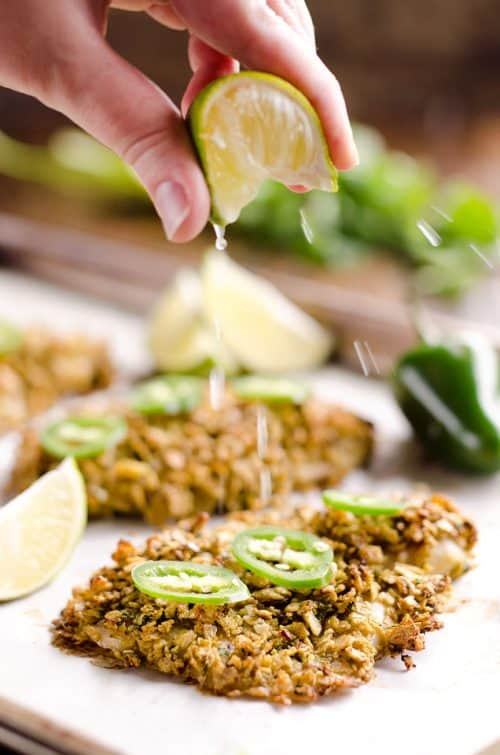Baked Tortilla Crusted Tilapia is a light and healthy dinner idea with a crunchy tortilla crust full of spicy southwestern flavors that is ready in less than 30 minutes!