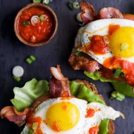 The ultimate BLT Sandwich topped off with an egg and spicy Harissa for one fantastic bite. This Open Faced BLT Sandwich is great for breakfast, lunch or dinner ... you make the choice! | joyfulhealthyeats.com