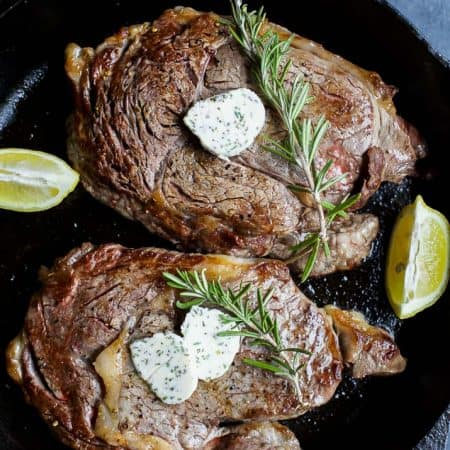 The perfect steak in just 15 minutes! Pan Seared Ribeye that's finished off in the oven and topped with homemade Herb Butter that will make you swoon! | joyfulhealthyeats.com #glutenfree Easy Dinner Ideas