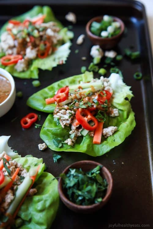 Three Thai Chicken Lettuce Wraps with Spicy Peanut Sauce on a Baking Sheet