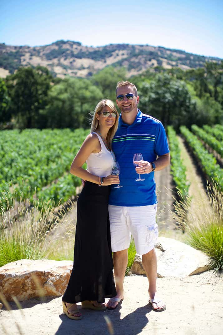 a couple in front of a stags leap winery vineyard in napa valley california