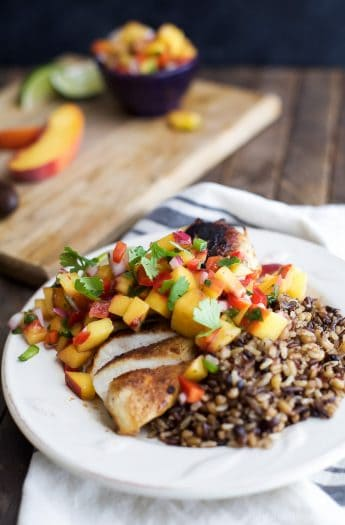 Pan Seared Chicken Breast with fresh Peach Salsa, a flavorful chicken dinner that's done in 30 minutes. It's the perfect meal for a school night! | joyfulhealthyeats.com #paleo #glutenfree