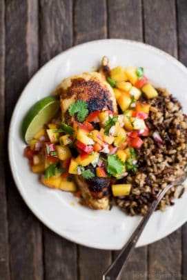 pan seared chicken with peach salsa on a plate