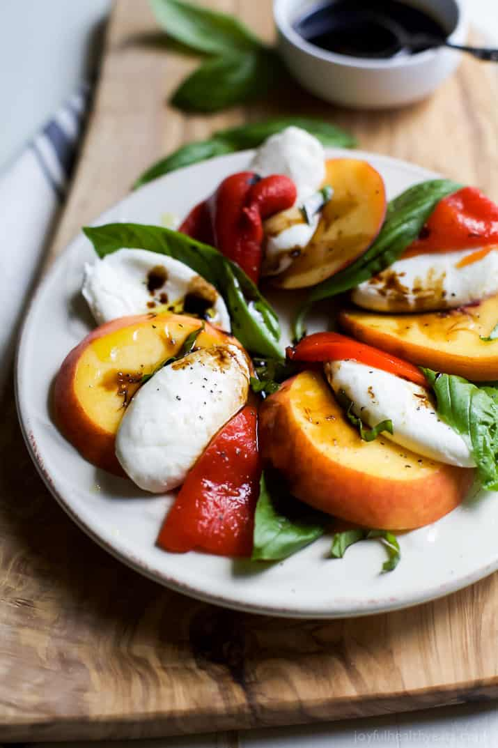 A light, refreshing, irresistible Roasted Red Pepper Peach Caprese drizzled with a homemade Balsamic Reduction. It's like a flavor bomb went off in your mouth! | joyfulhealthyeats.com #glutenfree #vegetarian