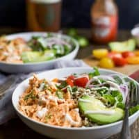 Buffalo Chicken Quinoa Bowls topped with avocado, tomato, shredded buffalo chicken, drizzled with ranch and served on a bed of quinoa. Football food just got a healthy facelift! | joyfulhealthyeats.com #glutenfree