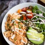 buffalo chicken quinoa in a bowl drizzled with ranch