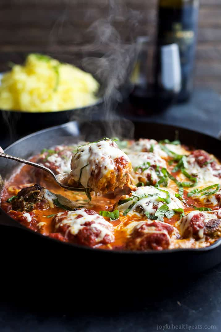 A pan of Cheesy Baked Turkey Meatballs cooked in Marinara sauce