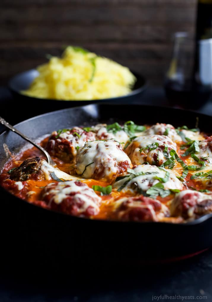 Cheesy Baked Turkey Meatballs cooked in Marinara sauce in a cast-iron skillet