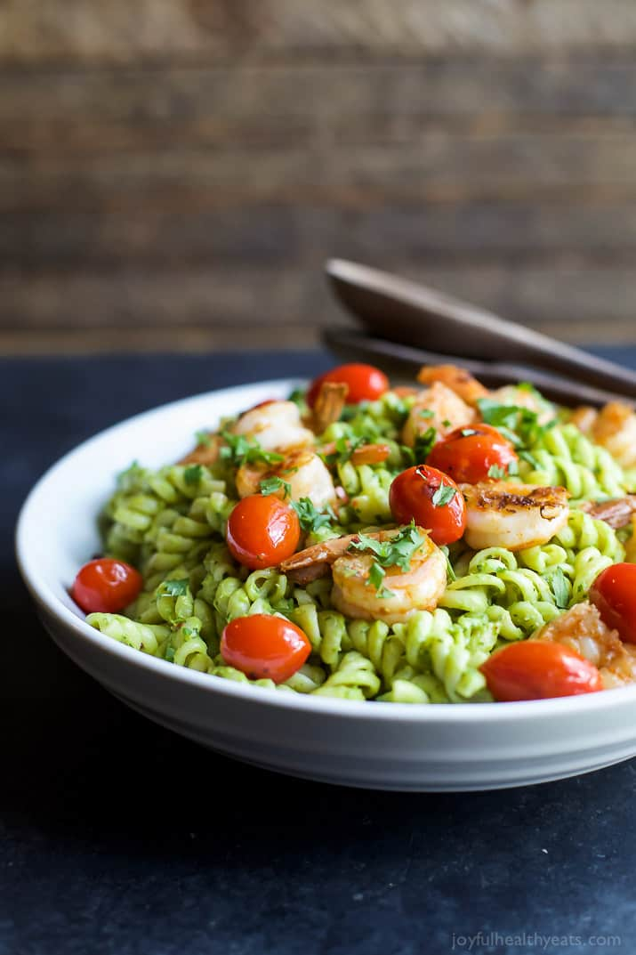 Chimichurri Avocado Pasta with Pan Seared Shrimp and grape tomatoes in a bowl