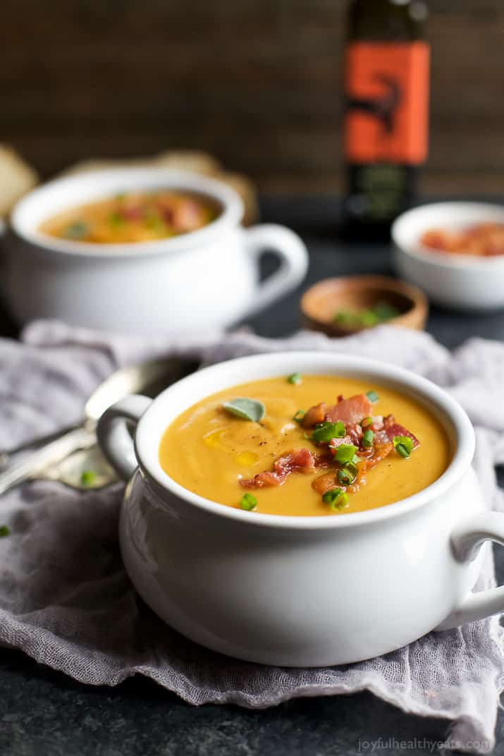 This Creamy Bacon Roasted Butternut Squash Soup is by far the best soup you'll have all fall! Creamy, full of rich flavor, 143 calories a serving, and only 45 minutes to make! Where's the spoon!? | joyfulhealthyeats.com #paleo #glutenfree