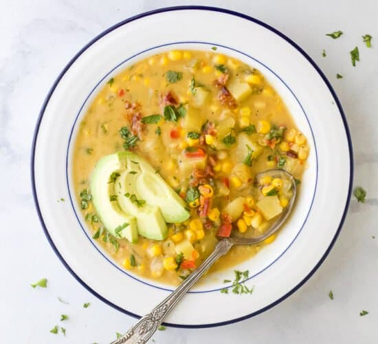overhead crock pot potato corn chowder in a bowl with a spoon