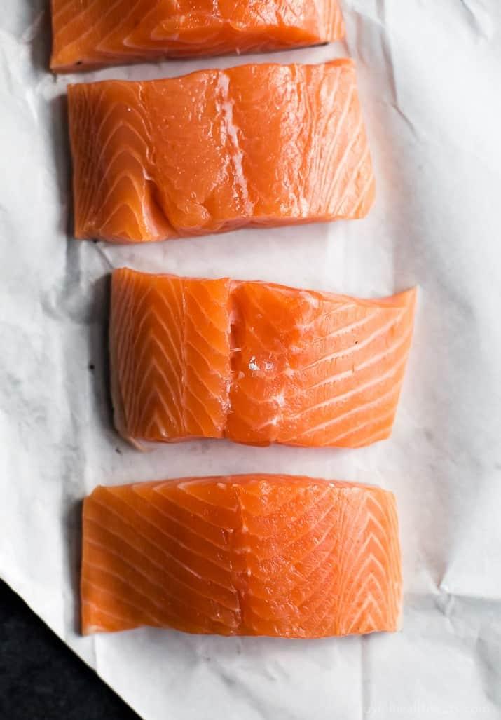 Raw salmon on white paper