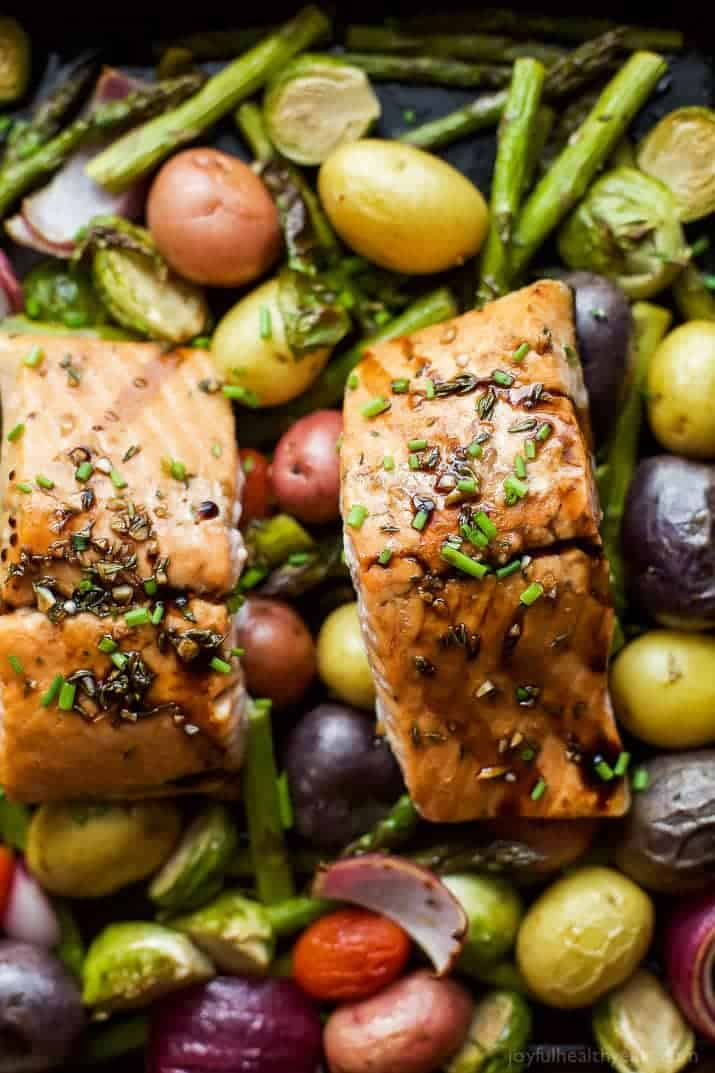 Balsamic Salmon on top of cooked potatoes, asparagus, and brussels sprouts