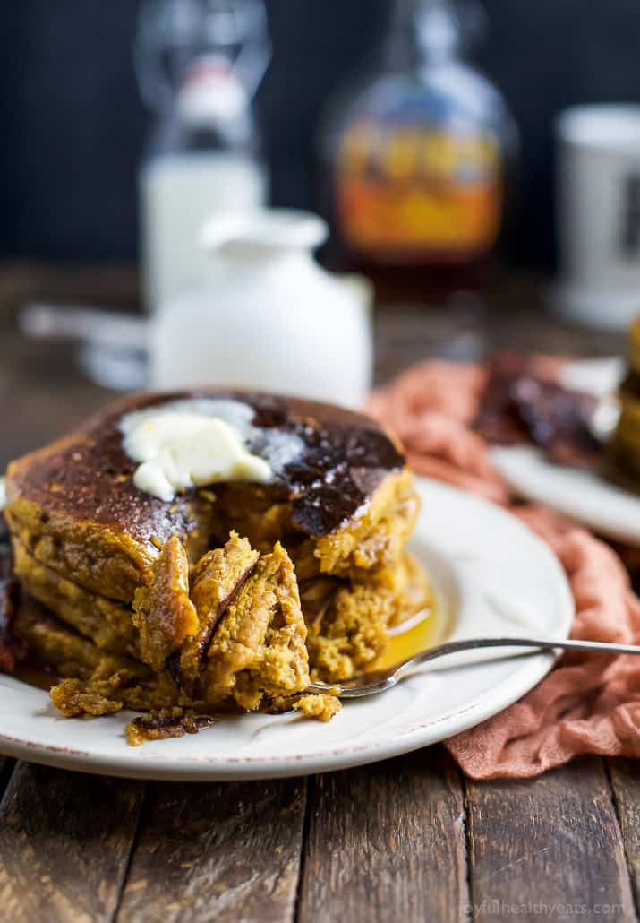 Start off your weekend with the perfect fall breakfast! Fluffy Whole Wheat Pumpkin Pancakes served with homemade Candied Bacon that will make you swoon! It's the ultimate salty sweet perfection! | joyfulhealthyeats.com