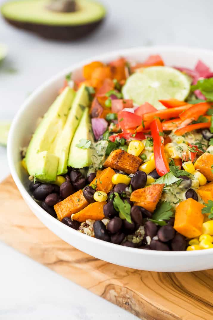 close up of easy sweet potato black bean quinoa bowls with crema