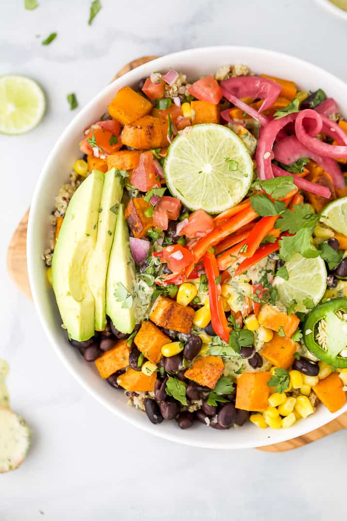 close up of easy sweet potato black bean quinoa bowls with crema and avocado