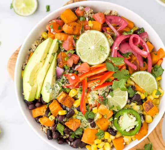 overhead photo of easy sweet potato black bean quinoa bowls with crema in a bowl