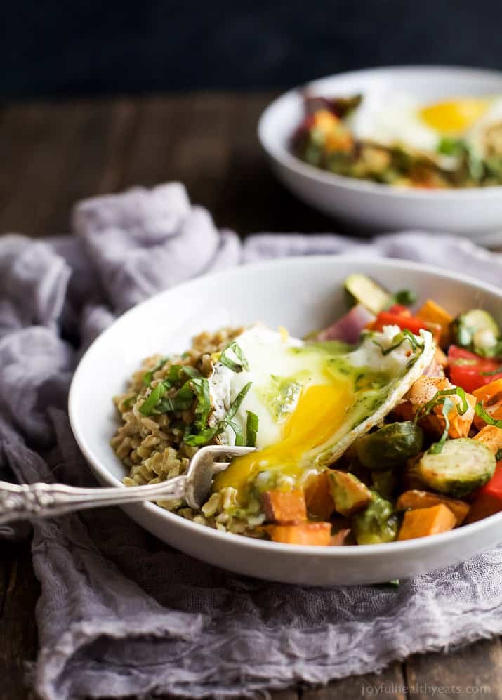 A Harvest Roasted Vegetable Grain Bowl topped with an egg