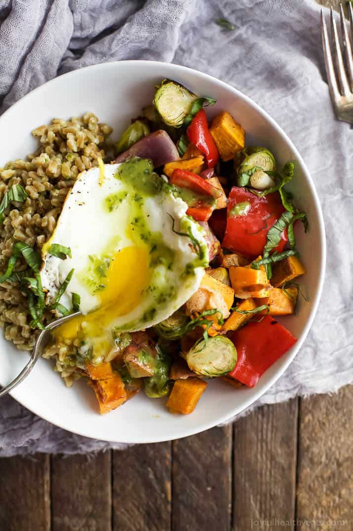 Top view of a Harvest Roasted Vegetable Grain Bowl topped with an egg