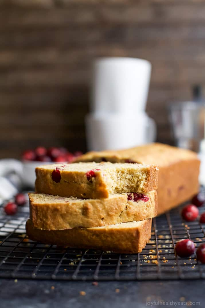 Moist Orange Cranberry Bread, made with fresh cranberries and fresh orange juice. This Cranberry Orange Bread is one of the BEST things you'll have all fall! | joyfulhealthyeats.com