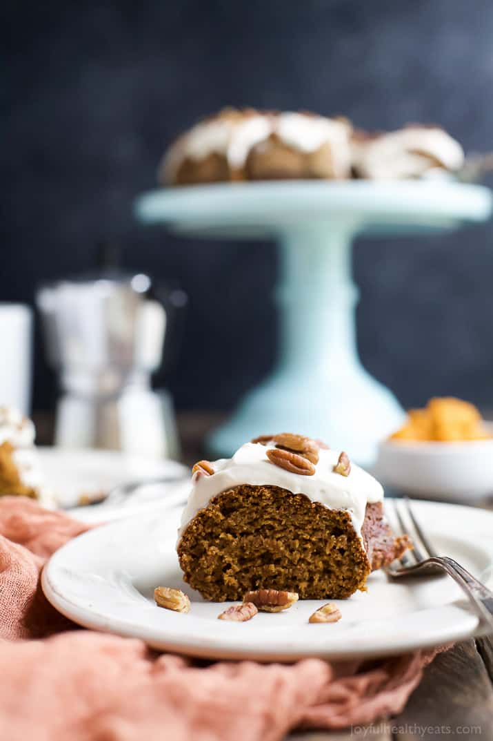 A Piece of Pumpkin Bundt Cake on a Plate with a Fork