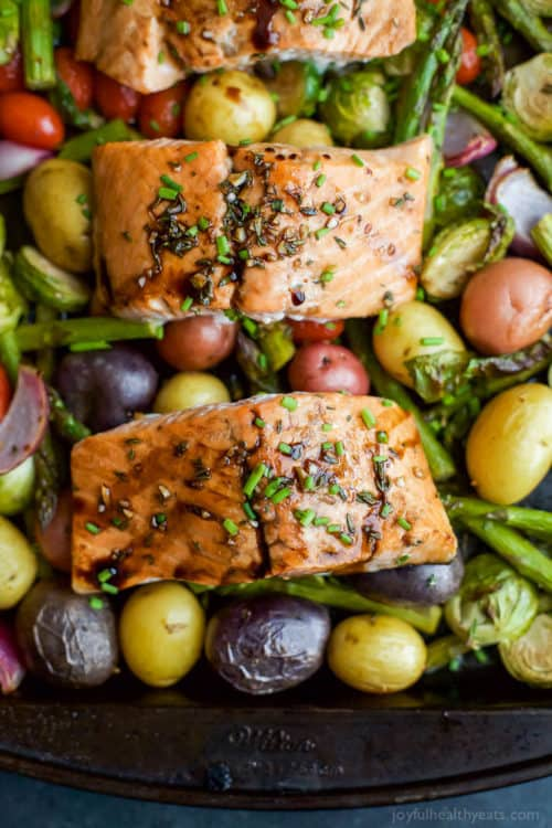 Sheet Pan Balsamic Salmon on a bed of potatoes, asparagus, and brussels sprouts! An easy healthy meal done in 30 minutes and full of bold flavors you'll love!