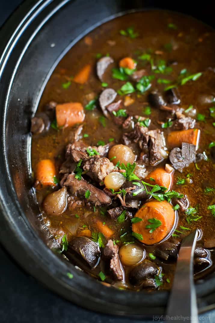 A slow cooker with beef bourguignon