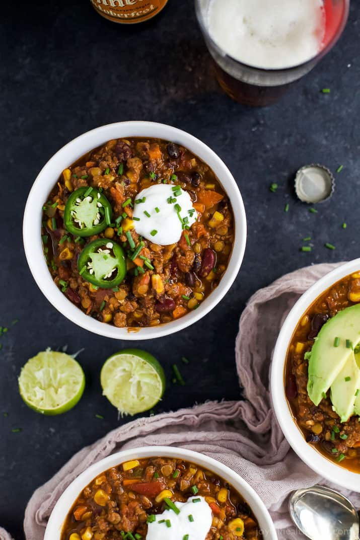 A hearty one pot Smoky Lentil Chili recipe perfect for those cold winter nights! This Lentil Chili has a rich smoky flavor, packed with vegetables, high in protein and fiber and is absolutely comfort in a bowl! | joyfulhealthyeats.com #glutenfree