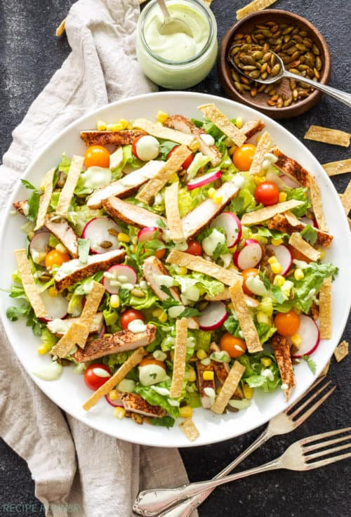 Salad as a main dish? You bet! This Southwest Chicken Salad with Avocado Lime Dressing is loaded with hearty toppings and won't leave you hungry!