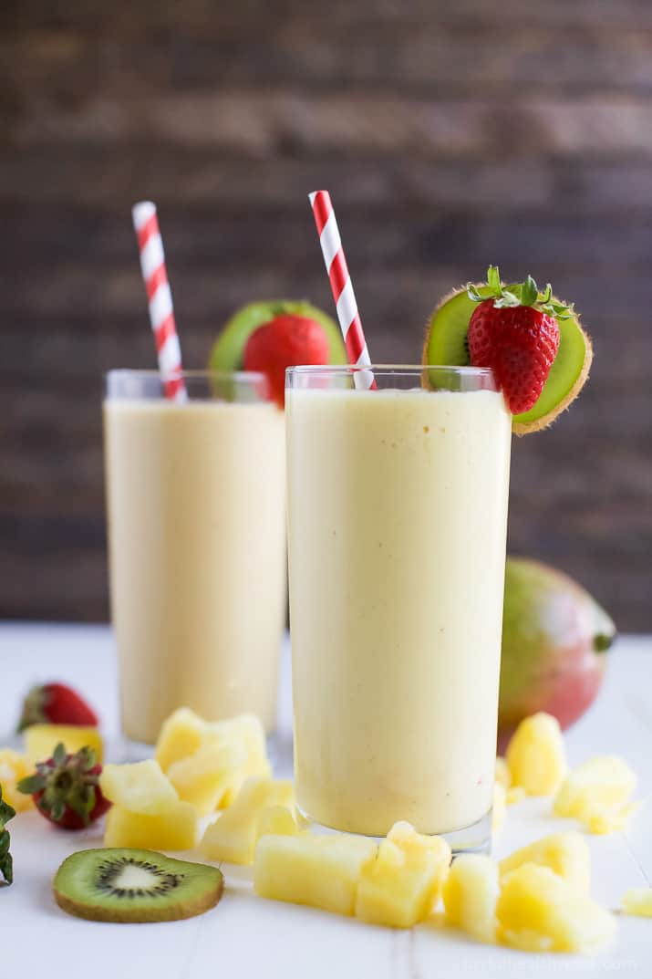 This refreshing Tropical Mango Smoothie is the perfect way to start your day. Fresh flavors that will take you straight to the beach and with 21 grams of protein! | joyfulhealthyeats.com | #drinkitallin #ad