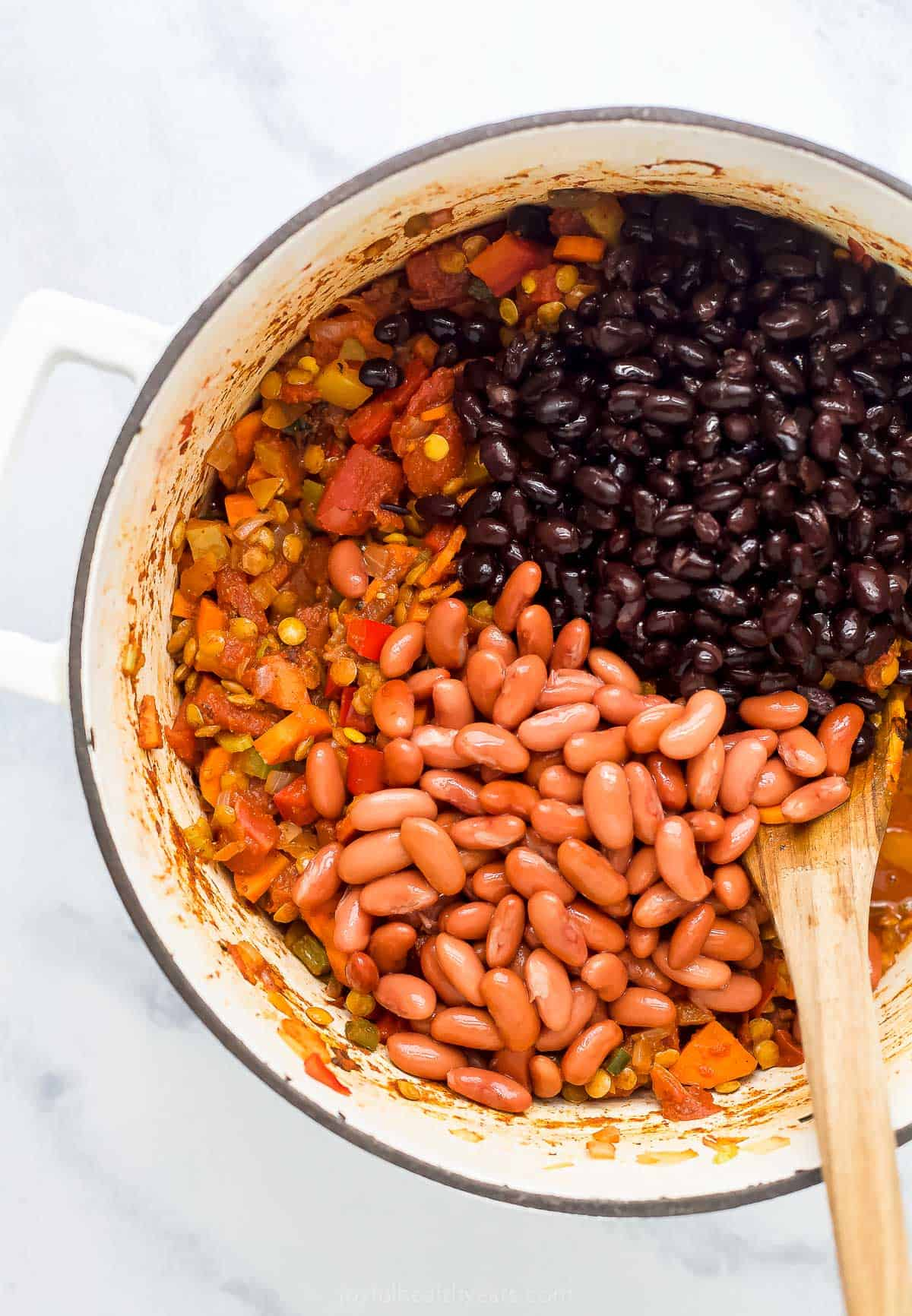 lentil chili with beans in a dutch oven