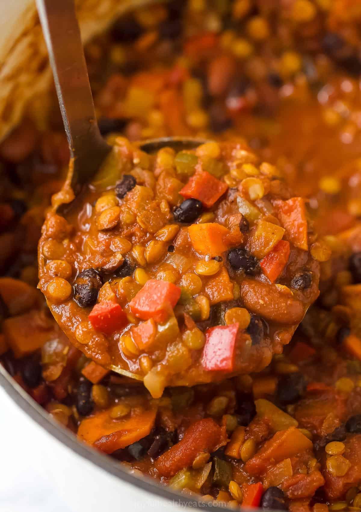 ladel scooping lentil chili