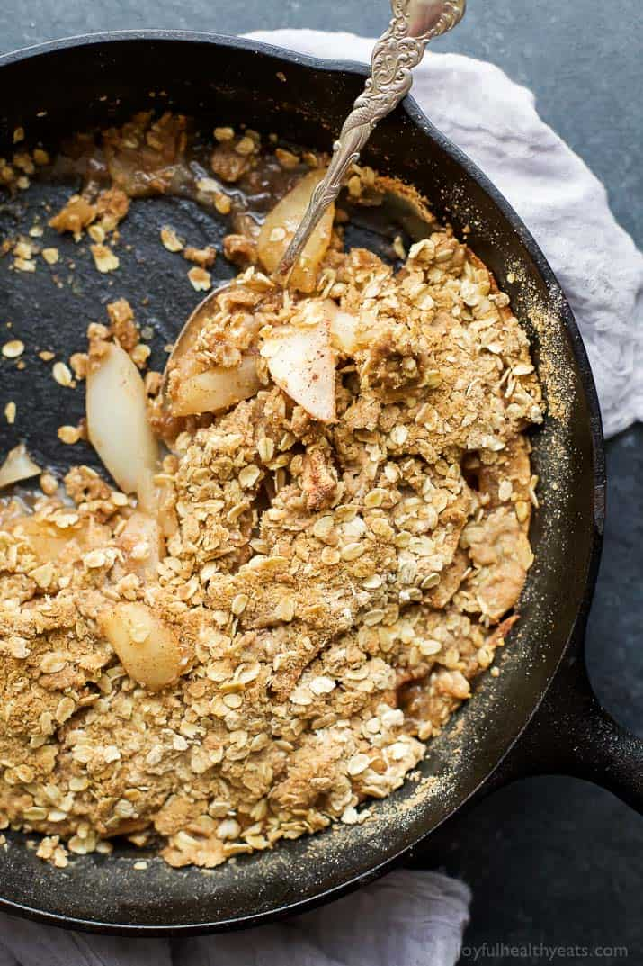A divine CINNAMON APPLE PEAR CRISP that will take you to dessert bliss in one bite. The oatmeal topping is incredible with the perfect amount of crunch and uses less sugar than most. It's a must make dessert for the holidays! | joyfulhealthyeats.com