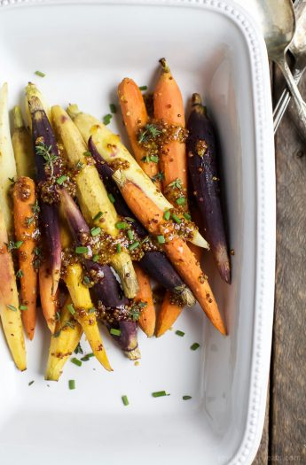 Jazz up your Carrots during the holidays with these RAINBOW MAPLE DIJON GLAZED CARROTS. Sprinkle them with some fresh herbs for an extra pop of flavor! These are a must for your dinner table this Thanksgiving! | joyfulhealthyeats.com #glutenfree