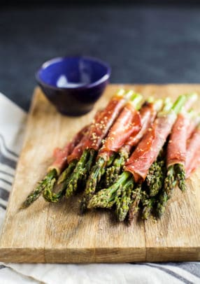 Prosciutto Wrapped Asparagus - one of the easiest recipes you'll make using just two ingredients! Perfect for an appetizer, snack, or side dish for the holidays!   joyfulhealthyeats.com #glutenfree