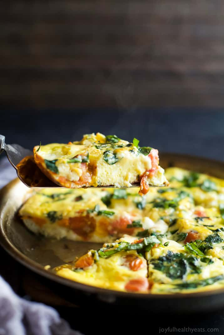 ROASTED TOMATO CAPRESE FRITTATA, an easy yet fancy looking holiday recipe that's perfect for breakfast, brunch or lunch! Filled with melted mozzarella, fresh basil, garlic infused spinach and roasted tomato - it's pretty much divine! | joyfulhealthyeats.com