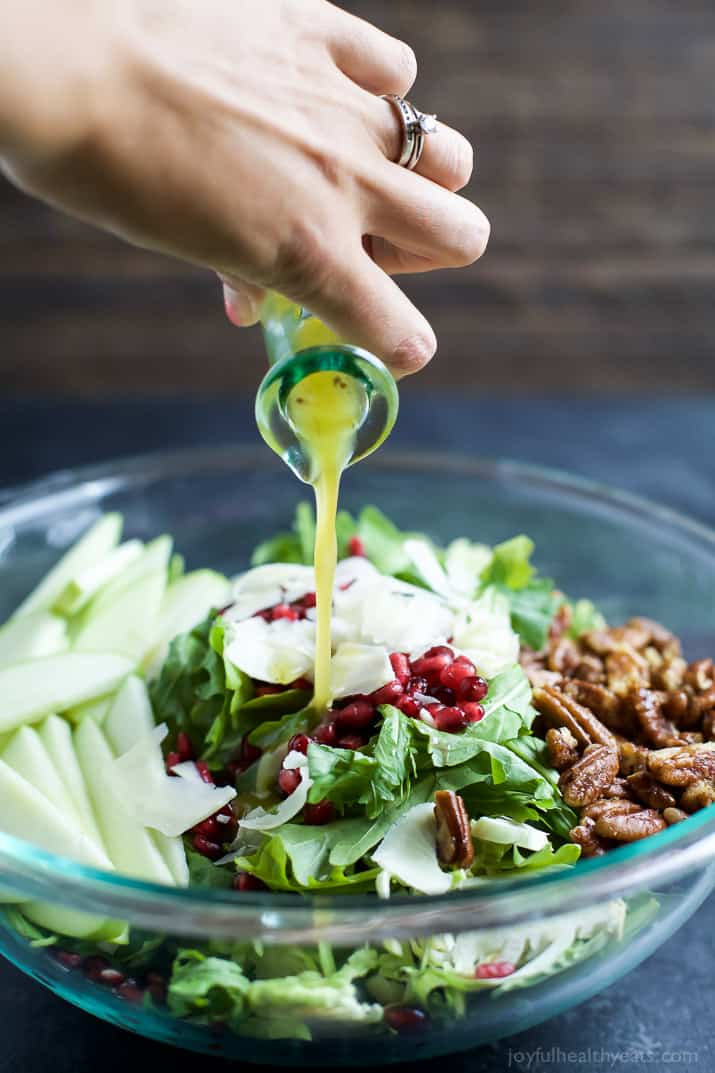 Shaved Brussel Sprout Salad filled with apples, pomegranate, candied pecans, and white cheddar cheese then tossed with a light Lemon Vinaigrette. This Brussel Sprout Salad is the perfect side dish for the holidays! | joyfulhealthyeats.com #glutenfree