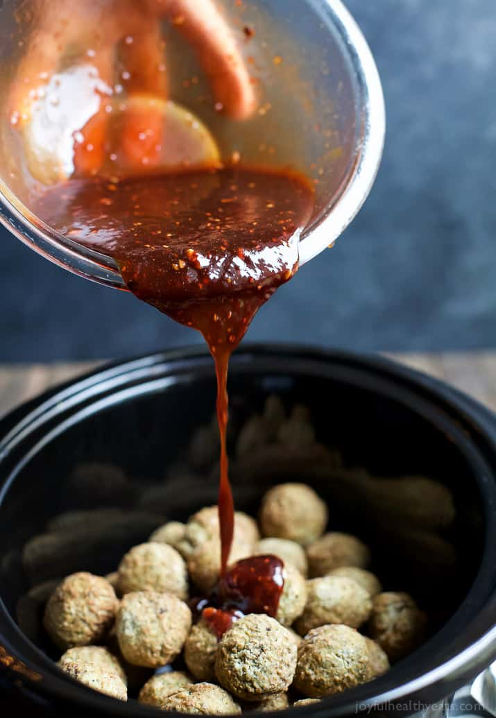 Asian Crockpot Meatballs covered in a sweet and spicy sauce you'll swoon over! An appetizer recipe you'll devour in seconds!