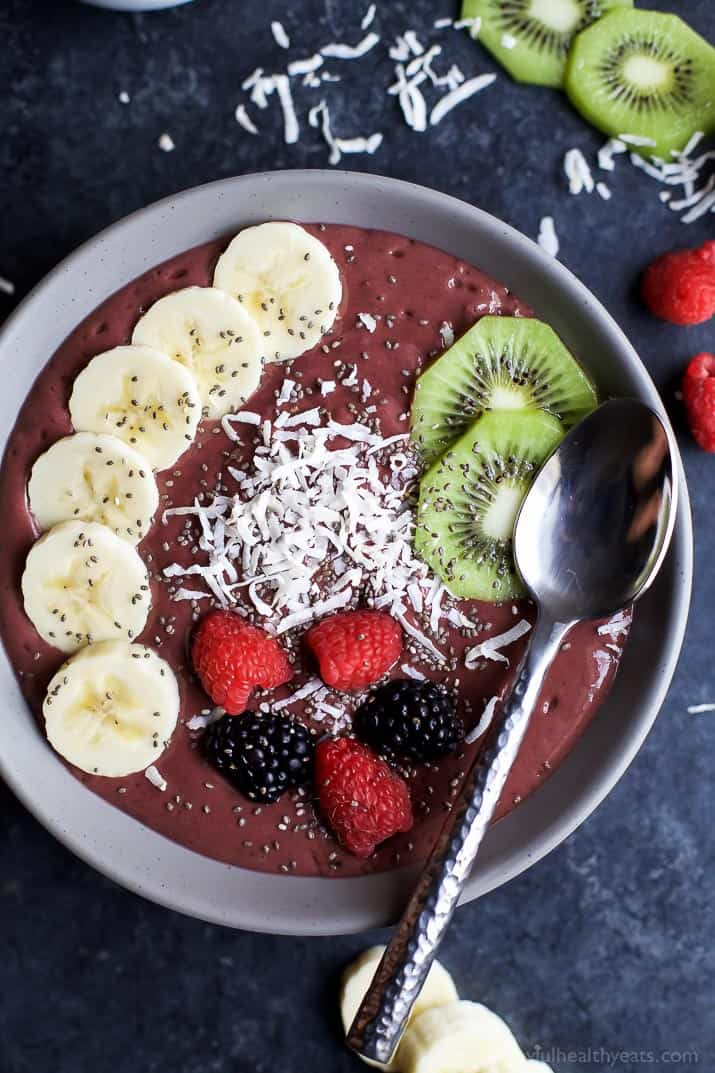 BANANA BERRY SMOOTHIE BOWL with banana slices, kiwi, fresh berries and coconut