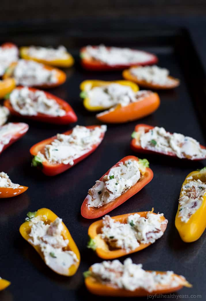 CHEESY BACON STUFFED PEPPERS, everything about this delicious appetizer is addicting! Perfect for the holidays! Top these little pepper bites with a dab of pepper jelly and I guarantee you'll be in a heaven! | joyfulhealthyeats.com #glutenfree