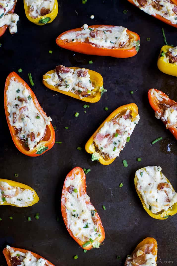 Top view of mini bell pepper halves stuffed with cheesy bacon filling