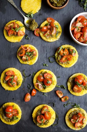 Crispy Polenta Bites with a Basil Pesto spread and topped with fresh Tomato Bruschetta. | Gluten Free Recipes | Vegetarian Recipes | joyfulhealthyeats.com