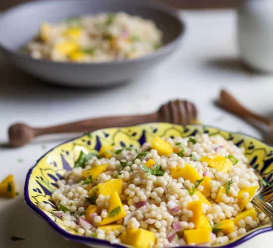 An Easy Mango Couscous Salad packed with sweet mango and a light dressing. This salad is a quick 15 minute side dish you're family will love, perfect with seafood or chicken. | joyfulhealthyeats.com