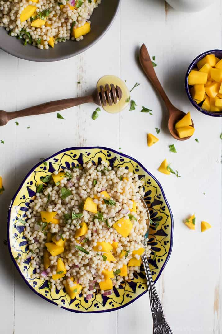 An Easy Mango Couscous Salad packed with sweet mango and a light dressing. This salad is a quick 15 minute side dish you're family will love, perfect with seafood or chicken.   joyfulhealthyeats.com