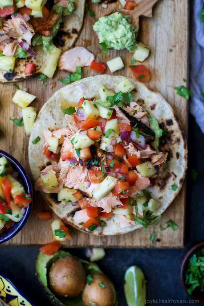 PINEAPPLE CHIPOTLE SALMON TOSTADAS - slightly charred smoky Salmon combined with Spicy Pineapple Salsa and creamy Avocados. These Tostadas take 30 minutes to make and are only 283 calories, a must make for a busy weeknight! | joyfulhealthyeats.com | gluten free recipes