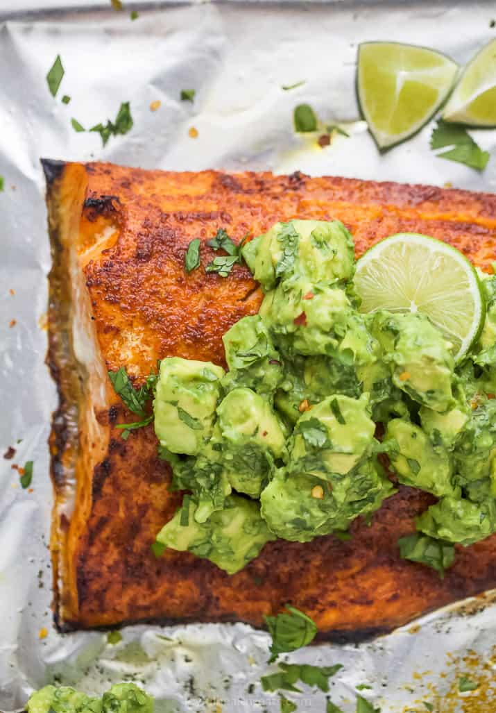 spice rub oven baked salmon with avocado on top