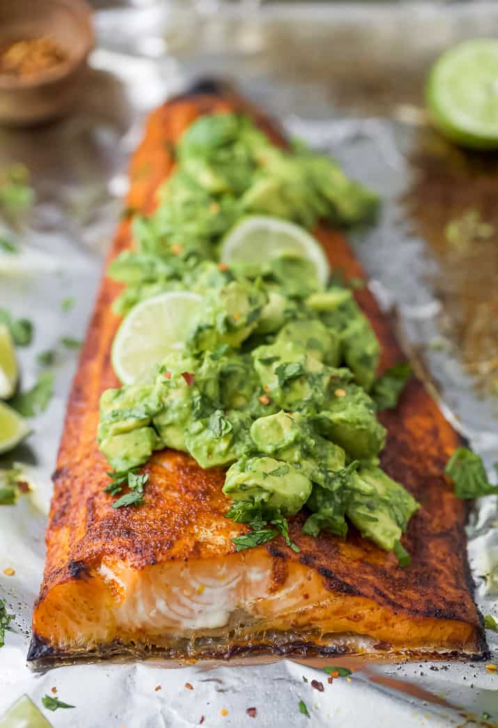 salmon with spice rub on it that's topped with avocado salsa