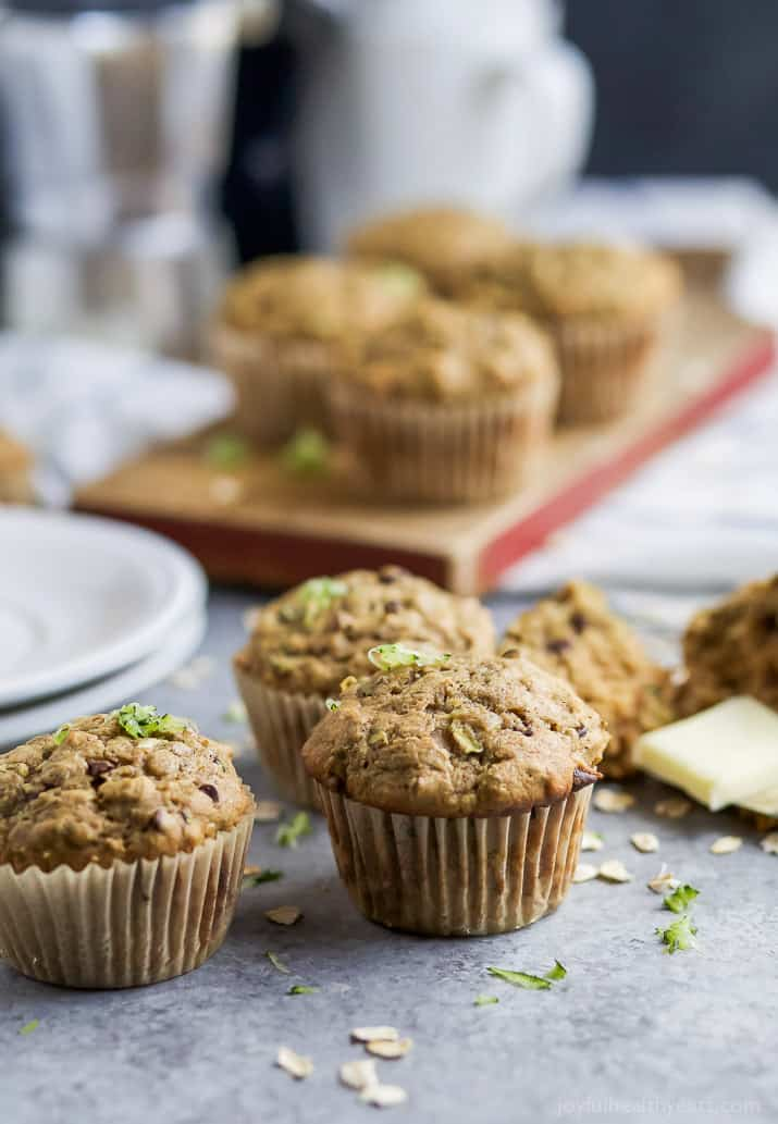 Chocolate Chip Zucchini Muffins on a countertop and cutting board